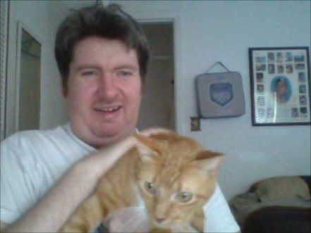 Say hello to my little friend: clowning around with my landlord's cat, Harry, back in July.
