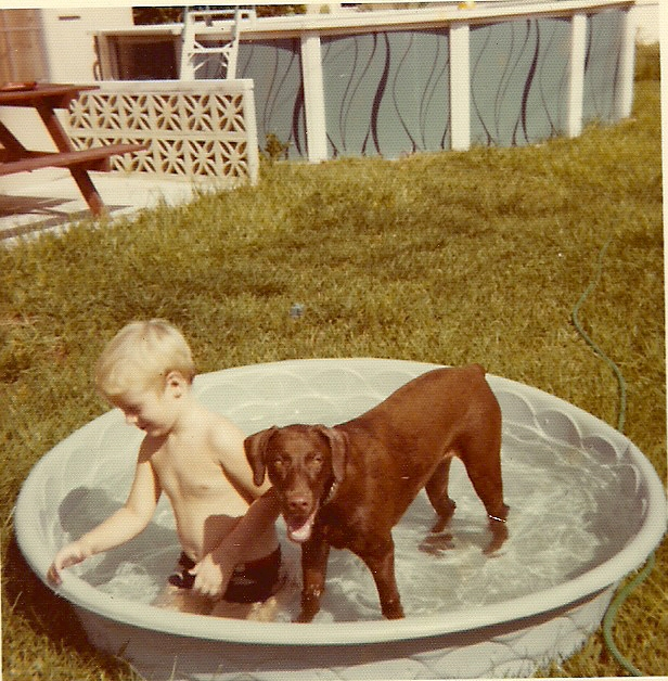 Me and the dog I grew up with, Ginger, sometime around 1976.