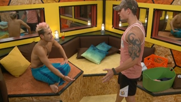 Frankie Grande (left) discusses things with fellow Big Brother contestant Caleb Reynolds (right) on July 28, 2014.