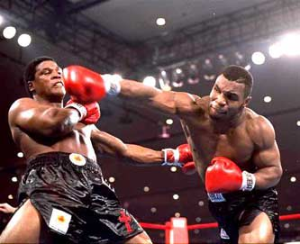 Trevor Berbick and Mike Tyson fighting it out on November 22, 1986.  Tyson won the fight to become one of the youngest champions in boxing history at just 20 years of age that night.
