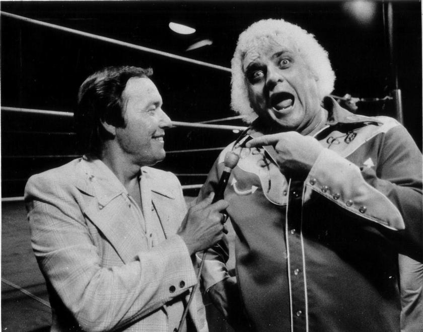 Gordon Solie and Dusty Rhodes sharing a light moment at the old Tampa Sportatorium.