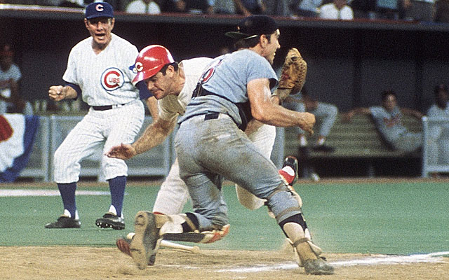 """Pete Rose (in the red """"C"""" cap) slams into Ray Fosse during the 1970 All-Star game in Cincinnati."""